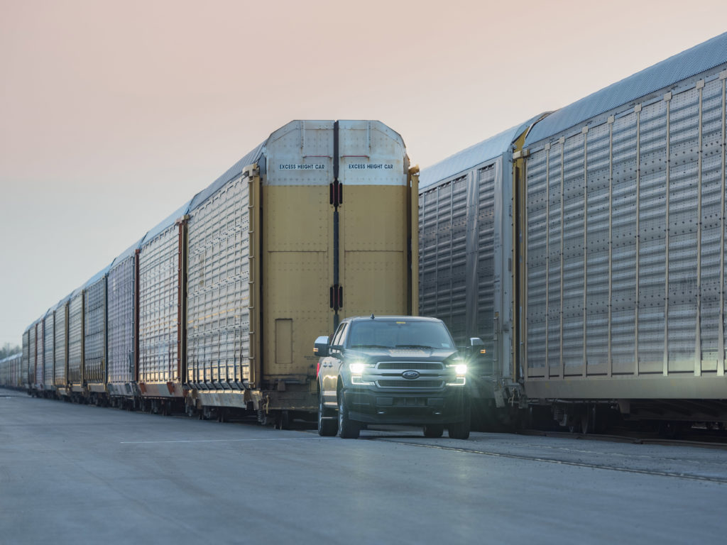Ford F-150 Lightning towing a train